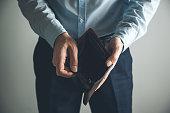 man hand  empty wallet on dark background