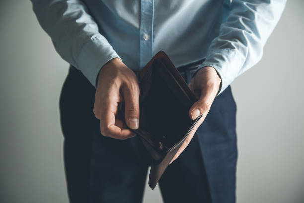 man hand  empty wallet - bankruptcy stock pictures, royalty-free photos & images