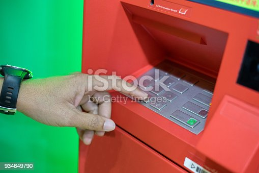 istock A man hand entering PIN/pass code on ATM/bank machine keypad 934649790