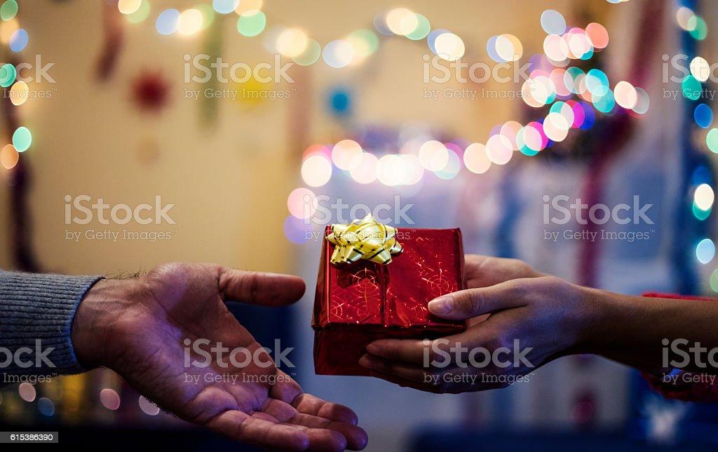 Man hand, giving , Christmas gift and woman hand. stock photo