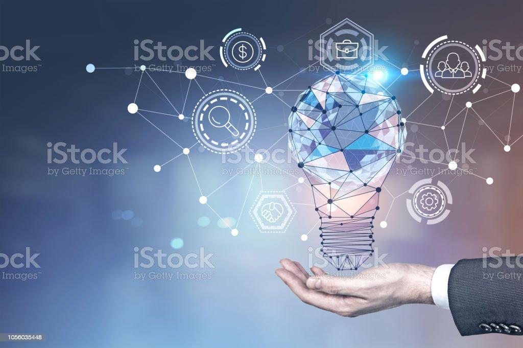 Man hand, glowing light bulb, network interface stock photo