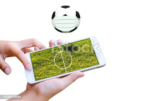 843298172 istock photo man hand hold and touch screen smartphone or cellphone isolated on white with football field on screen. 1226578334
