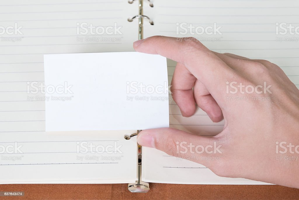 man hand hold business card stock photo