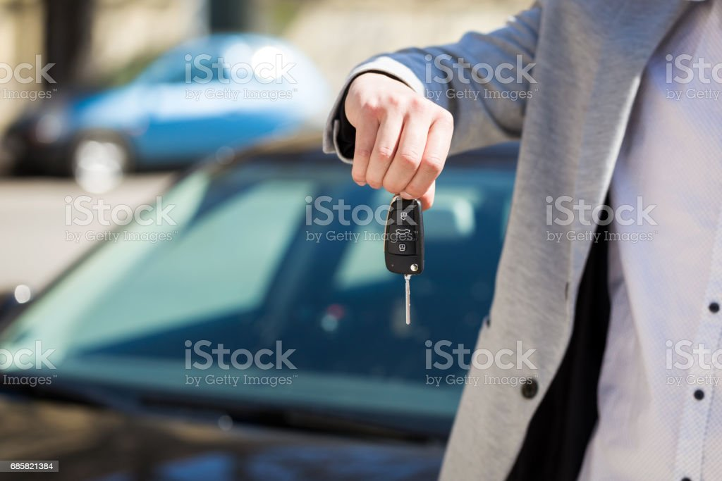 Man hand hold the remote control car alarm systems key stock photo