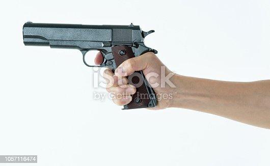 Man hand holding a gun on white background.