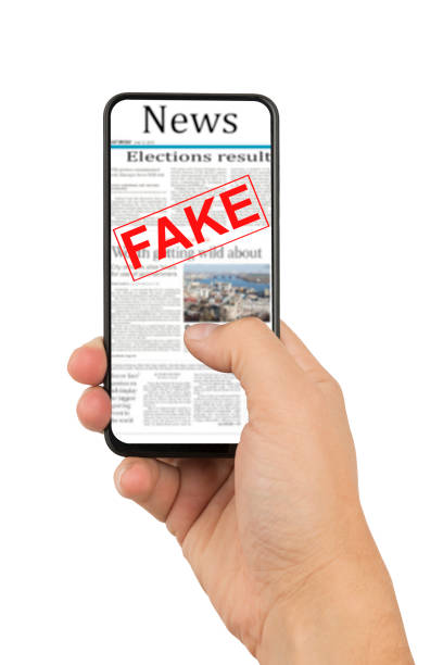 Man hand holding a smartphone with a page of fake news