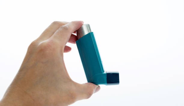 Man Hand Holding An Asthma Inhaler Stock Photo - Download Image ...