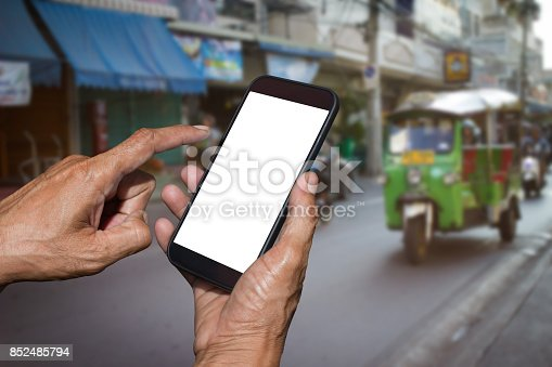 istock Man hand holding and using smart phone with isolated screen. 852485794