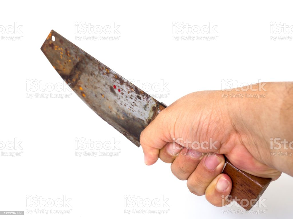 Man hand holding big kitchen rusty knife on white background (isolated background). stock photo