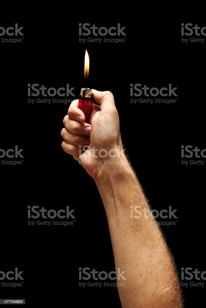 Man hand holding burning lighter stock photo