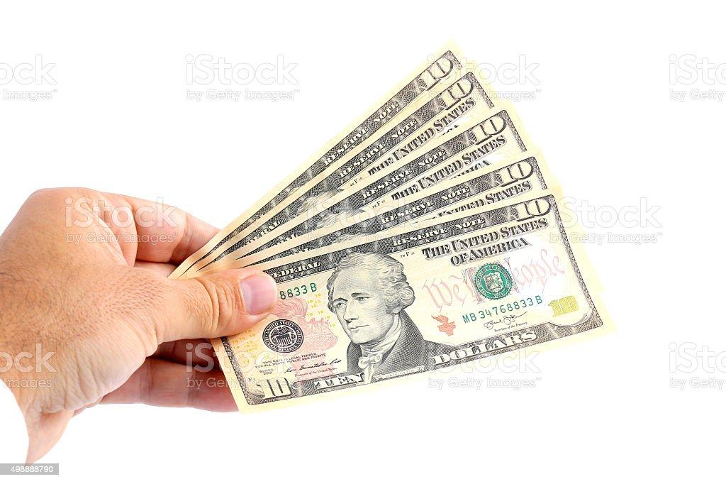man hand holding dollar bills stock photo