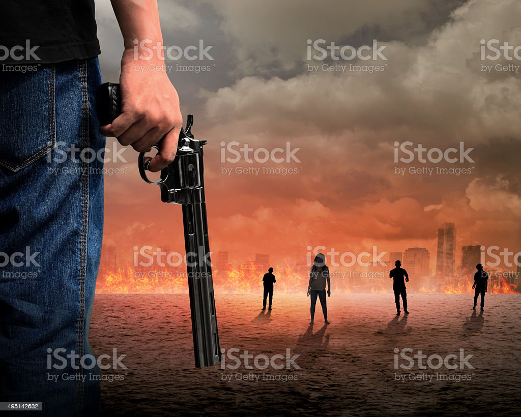 Man Hand Holding Gun Fighting Zombie stock photo