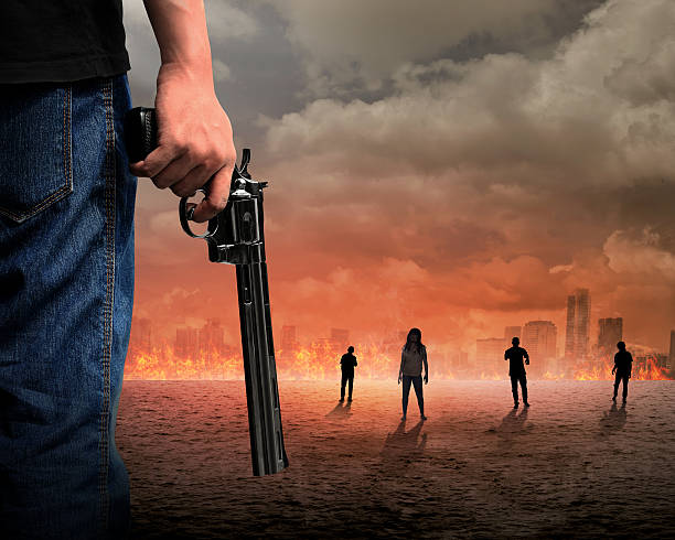 man hand holding gun fighting zombie - zombie apocalypse stock photos and pictures