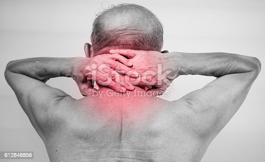 1133511905istockphoto man hand holding he neck and massaging in pain area 612848856