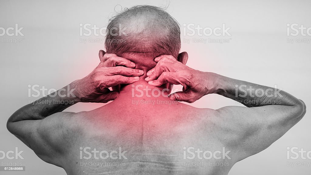 senior man hand holding he neck and massaging in pain area. red...