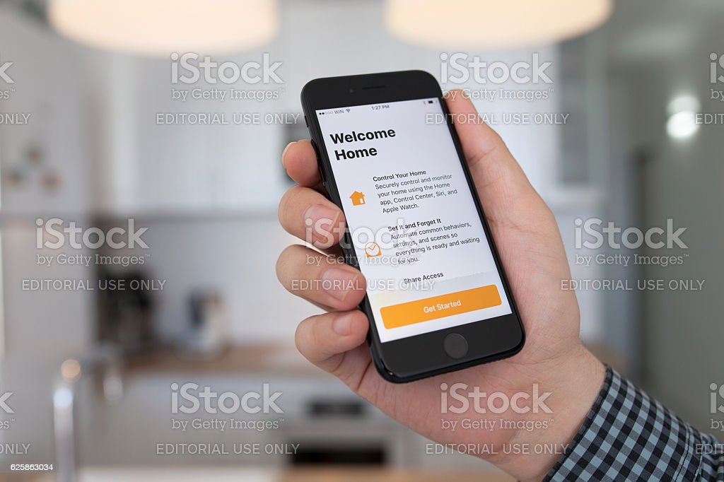 Man hand holding iPhone 7 Jet Black Onyx with Home stock photo