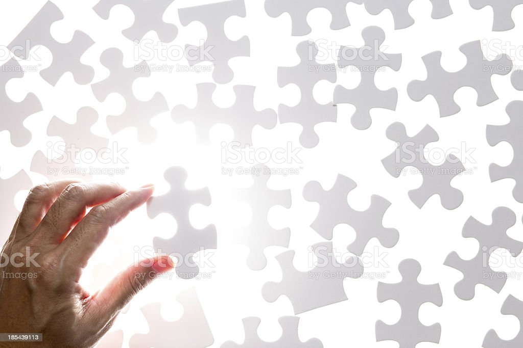 Man hand holding jigsaw puzzle piece royalty-free stock photo