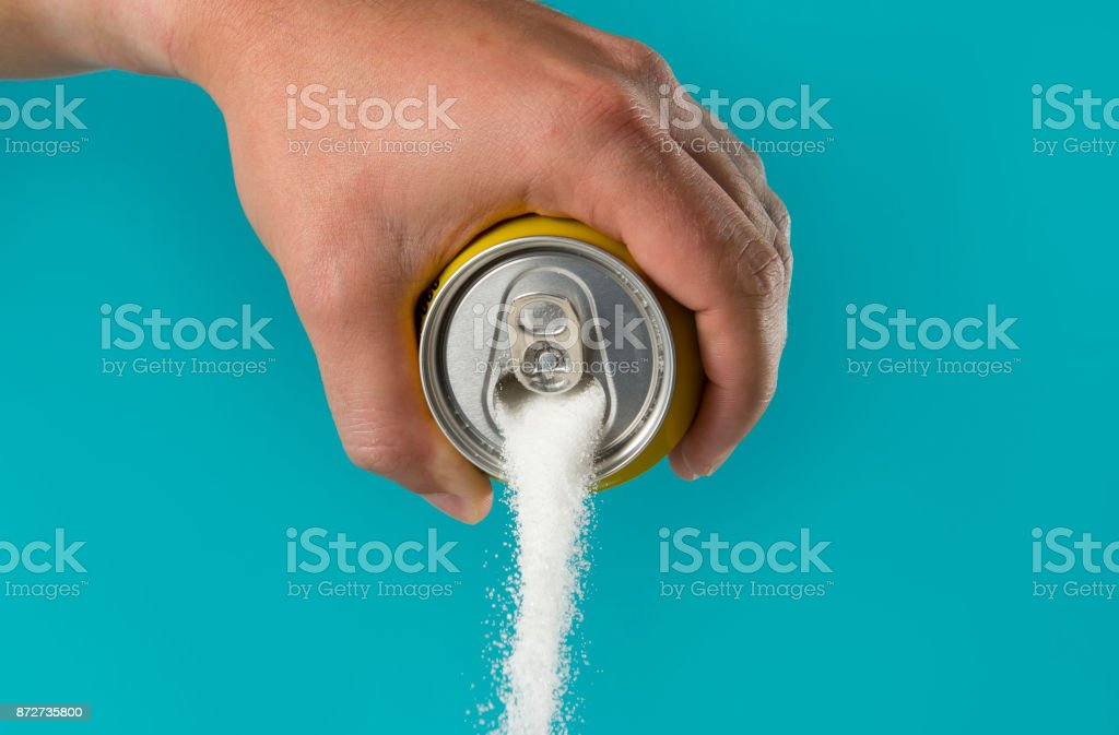man hand holding lemon refresh drink can pouring sugar stream in sweet and calories content of soda and energy drinks stock photo
