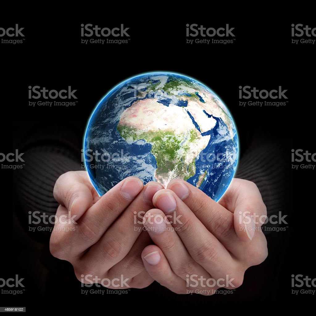 Man hand holding object ( Earth )  isolated on black background stock photo