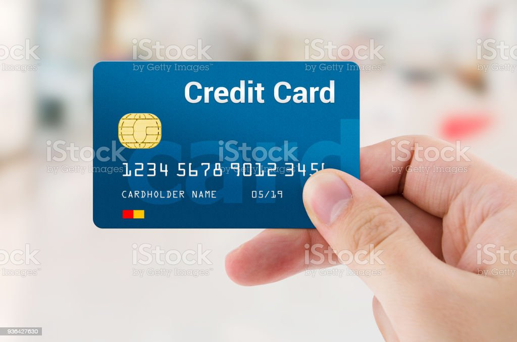 Man hand holding personal credit or debit card – zdjęcie