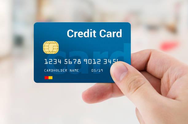 Man hand holding personal credit or debit card – zdjęcie