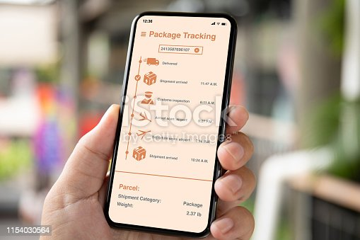 istock man hand holding phone with app tracking delivery package 1154030564