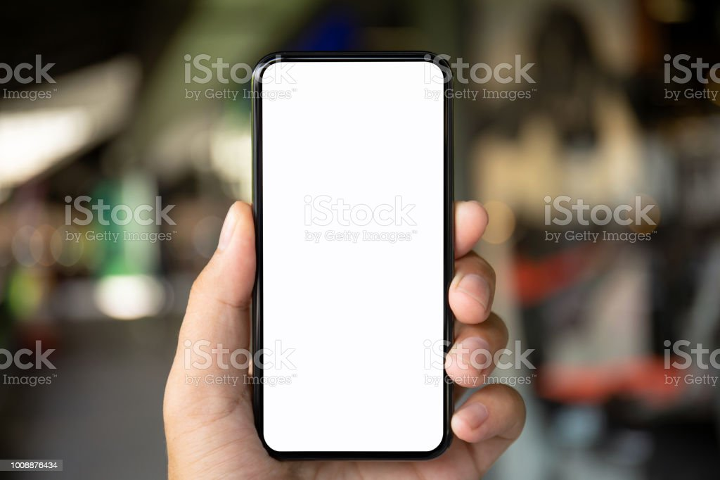 man hand holding phone with isolated screen on background city stock photo