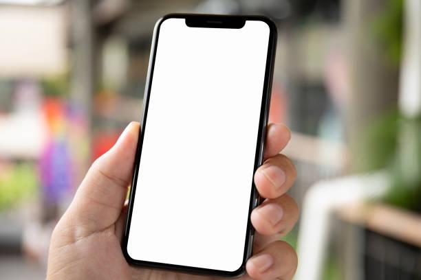 Hand des Mannes festhalten Telefon mit isolierten Bildschirm Hintergrund Stadt – Foto