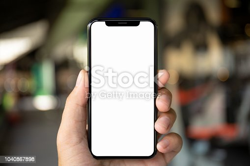 man hand holding phone with isolated screen on the background of a city street