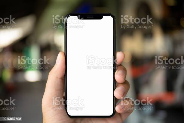 Man hand holding phone with isolated screen on background city picture id1040867898?b=1&k=6&m=1040867898&s=612x612&h=jhlqa8 qrvjspznlqr0rsqc5ktdkbotmxvbzsblrypc=