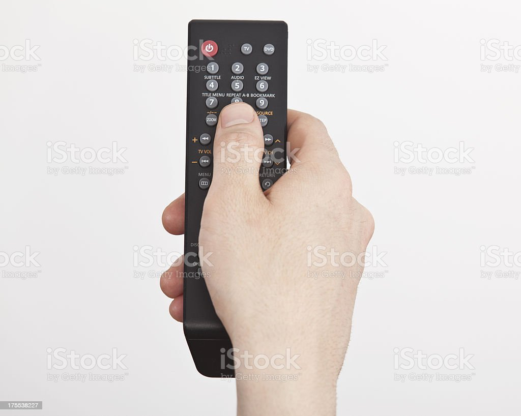 man hand holding remote control stock photo