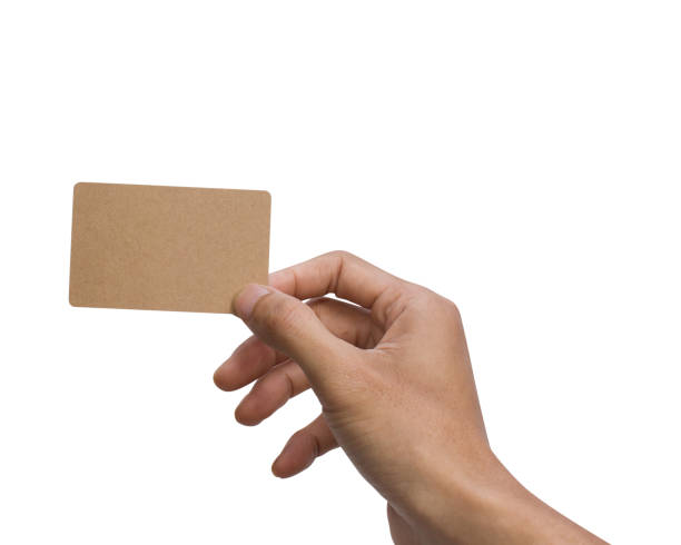 Man hand holding, showing, giving, present, brown empty card isolated on white background with clipping path for mock up or easy to moving for design your work. stock photo