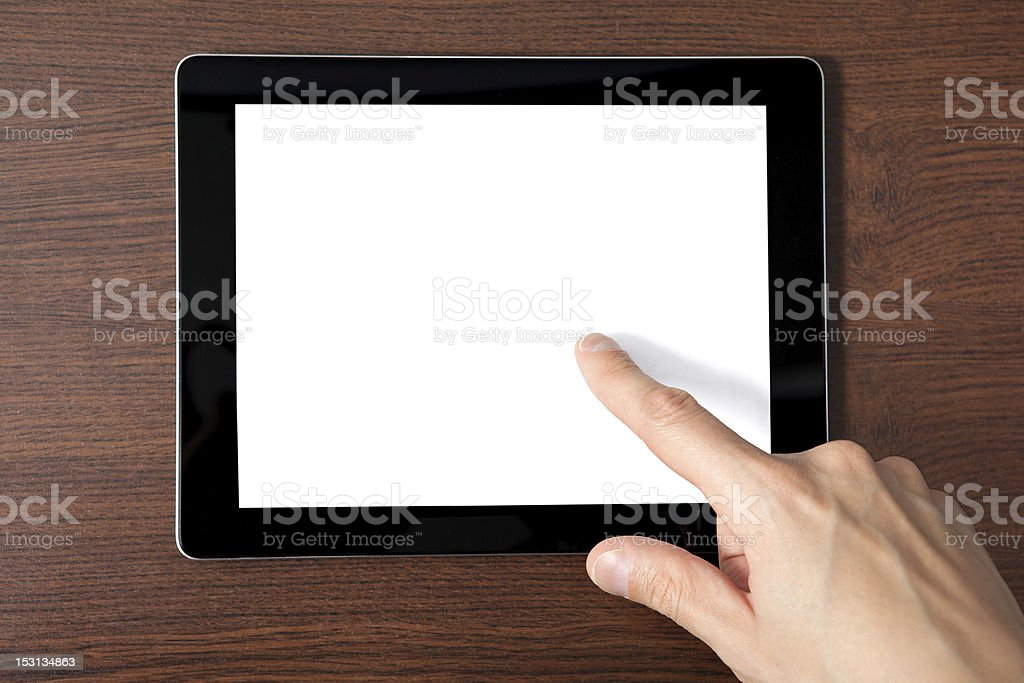 man hand holding tablet with a isolated screen royalty-free stock photo