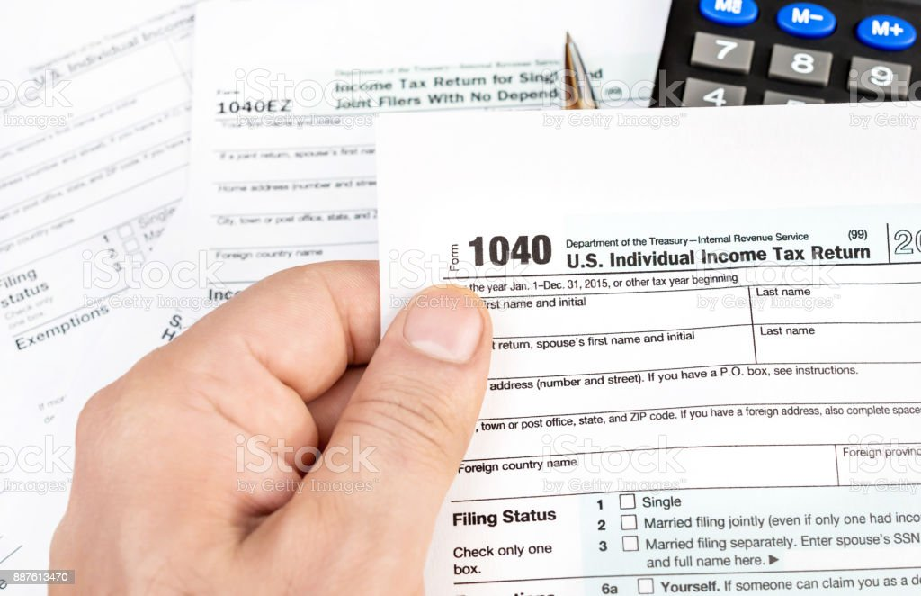 Man hand holding tax form. Business concept. stock photo