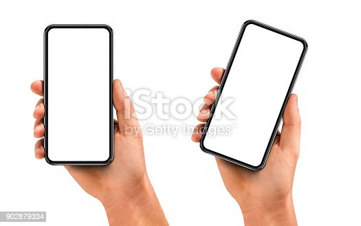 istock Man hand holding the black smartphone with blank screen and modern frame less design 902879334