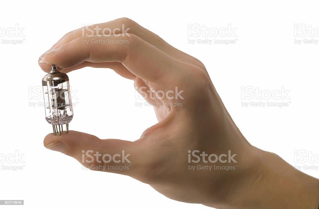 Man hand holding vacuum tube royalty-free stock photo