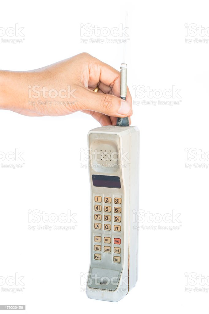 man hand holding vintage mobile phone Isolated stock photo