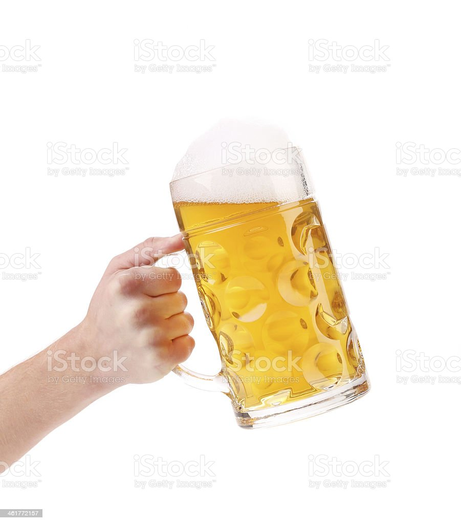 Man hand holds beer in mug. stock photo