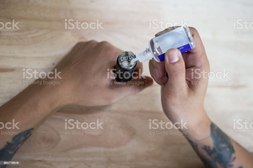 Man hand holds electric cigarette. royalty-free stock photo