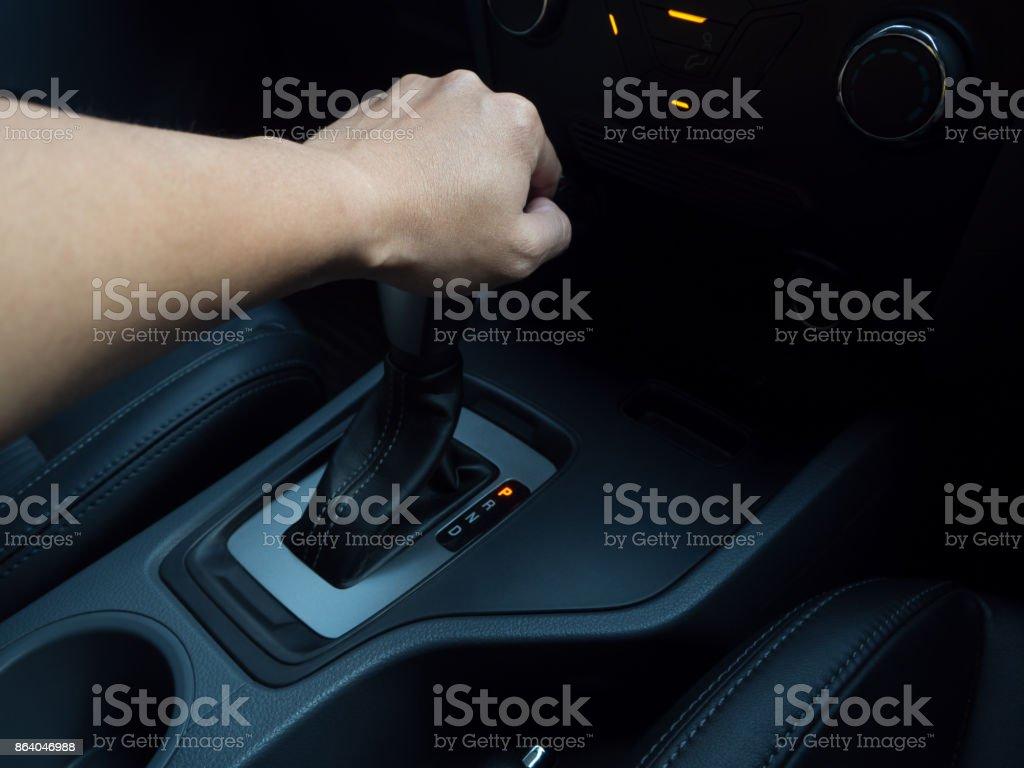 Man hand on auto gear stock photo
