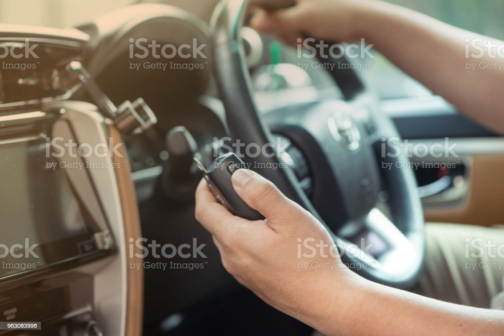 Man hand on Mobile radio in his car stock photo