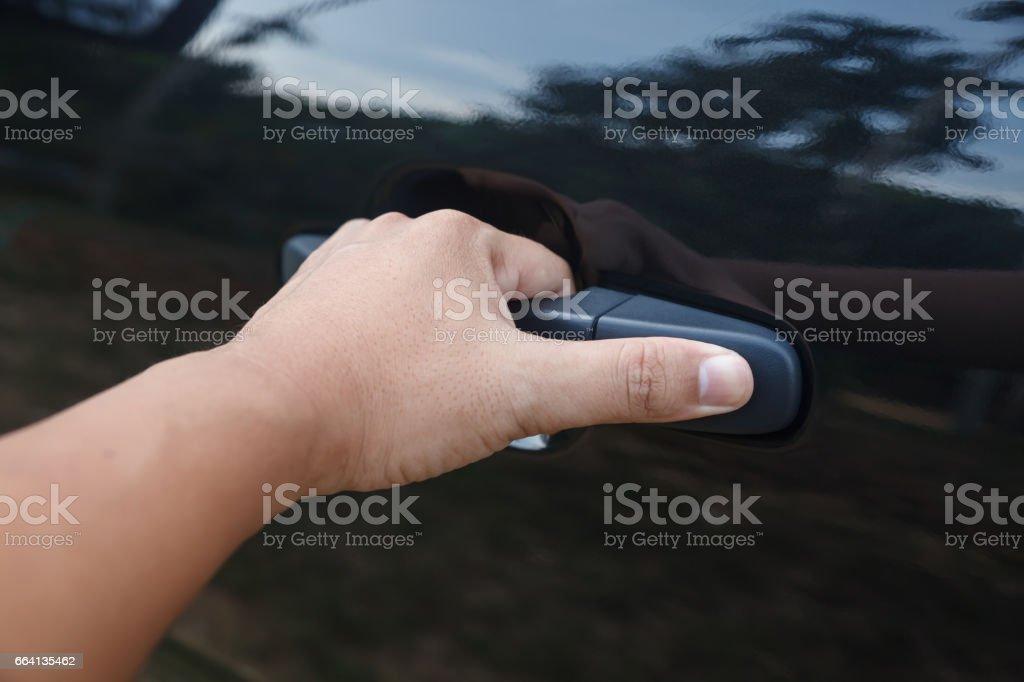 Man Hand Opens The Inner Door Handle. Stock Photo