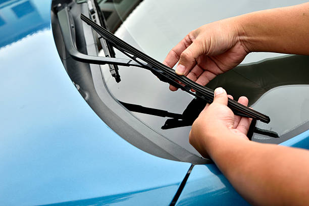 man hand picking up windscreen wiper man hand picking up windscreen wiper windshield wiper stock pictures, royalty-free photos & images