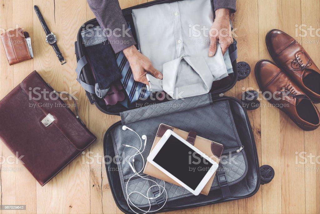 Man hand preparing business luggage royalty-free stock photo