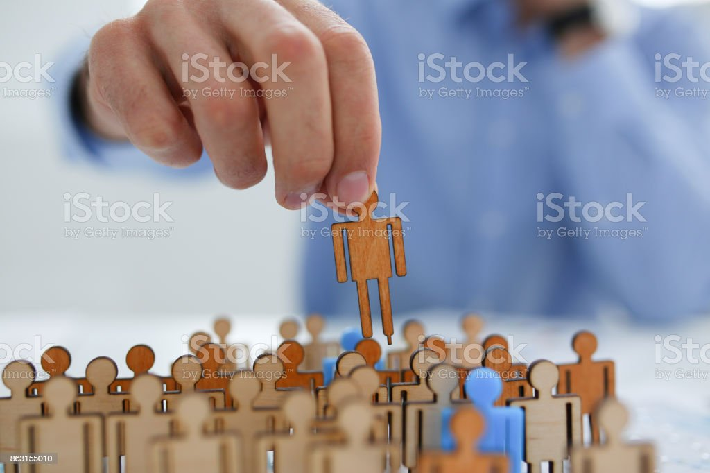 Man hand puts his blue silhouette on certain position organization stock photo