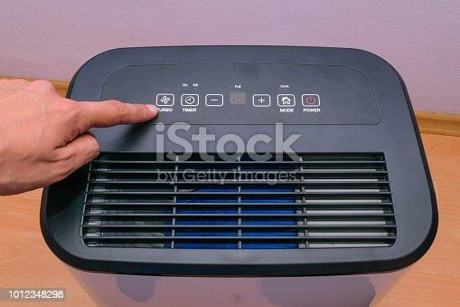 851700660 istock photo man hand setting up house hold dehumidifier 1012348298