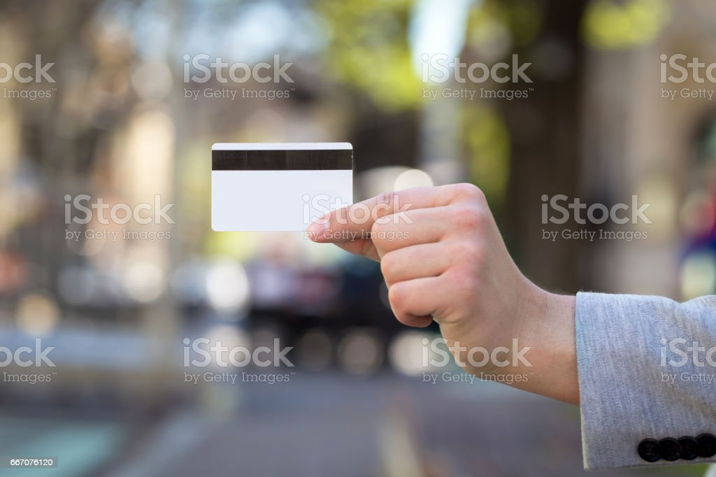 young man hand show credit card outdoor