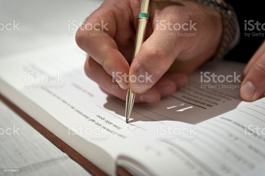 Man hand signing a contract royalty-free stock photo