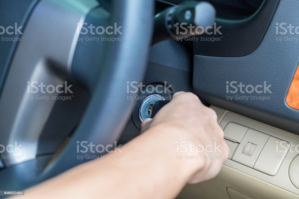 Man hand to take key starting van stock photo