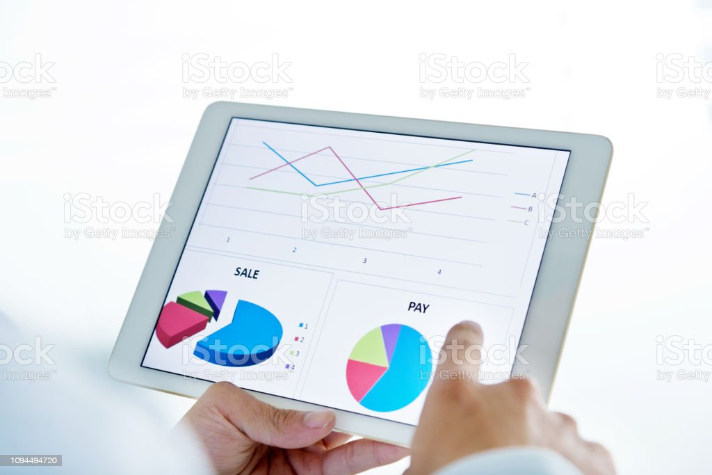 Man Hand Touching A Digital Tablet With Analyzing Graph